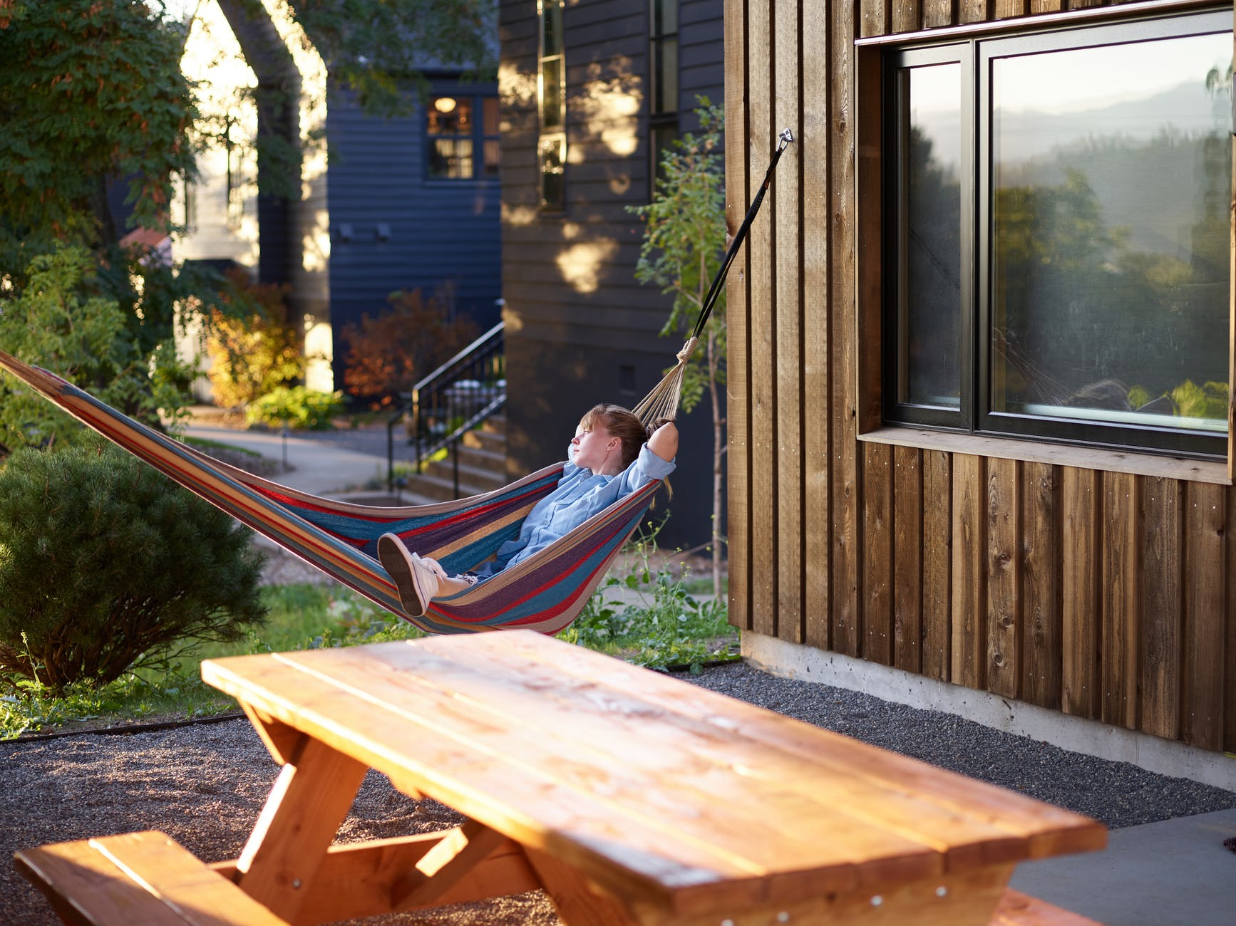 relaxed woman having nap in hammock